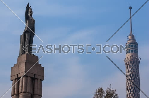 Zoom In Shot for Cairo Tower and Saad Zagloul Statue at Day