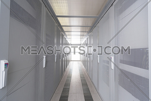 modern server room with white servers and hardwares in a internet data center