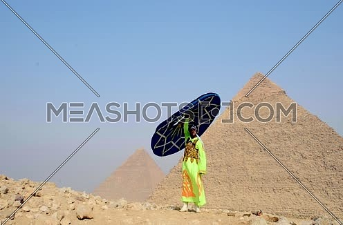 A sufi dancer with Tanoora at giza pyramids