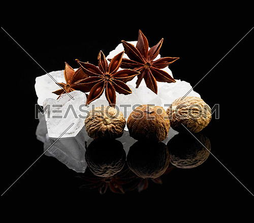 crystal sugar  over black reflective surface background