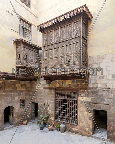 Facade of ottoman era historic house of El Sehemy with wooden oriel windows - Mashrabiya - located at Moez Street, Medieval Cairo, Egypt