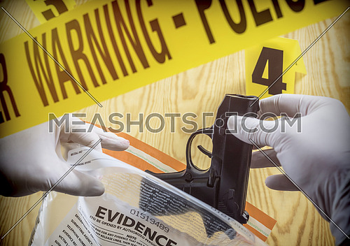 Crime scene for weapon, Police Scientific manipulating bag of evidence, conceptual image, conceptual image