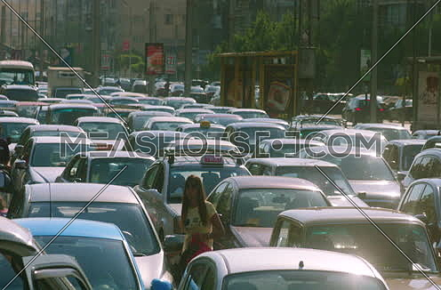 mid shot for a Traffic Jam in Cairo Downtown at noon