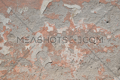 Background texture of old pink painted plaster gray cement wall with grunge stains and paint peeling