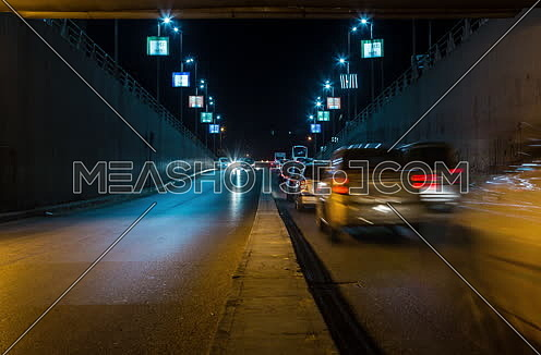 Zoom IN Shot for traffic from inside  Al Thawra Tunnel at Night