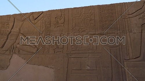 Orbit Shot for Writings on a wall at The Temple of Kom Ombo - Aswan, Egypt. by day