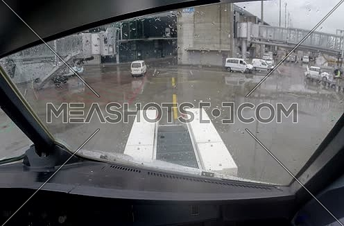 inside cockpit shot for plane taxiing at airport at rainy day