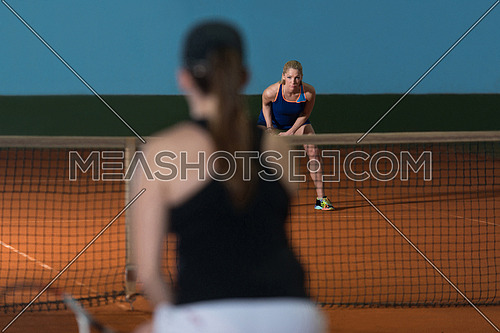 Portrait Of Two Beautiful Women Playing Tennis Indoor - Isolated On Black