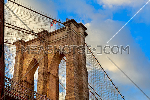 The Brooklyn Bridge, New York. Architectural detail at summer sunset. Brooklyn Bridge pylon