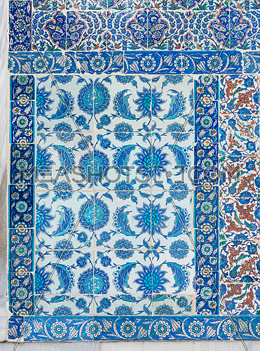 Old ceramic wall tiles with floral blue pattern in an exterior wall of the historic Eyup Sultan Mosque situated in the Eyup district, Istanbul, Turkey