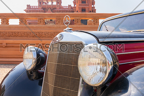 1953 Black and red Mercedes antique car, displayed in front of Baron Empain Palace, Cairo, Egypt