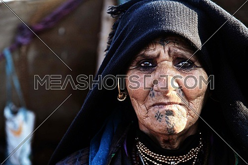 an old aged middle eastern woman looking towards the camera