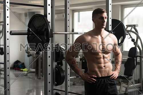 Good Looking And Attractive Young Man With Muscular Body Standing In Gym And Relaxing In Gym