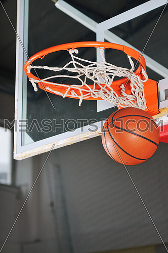 oreange basket ball in basketball basket