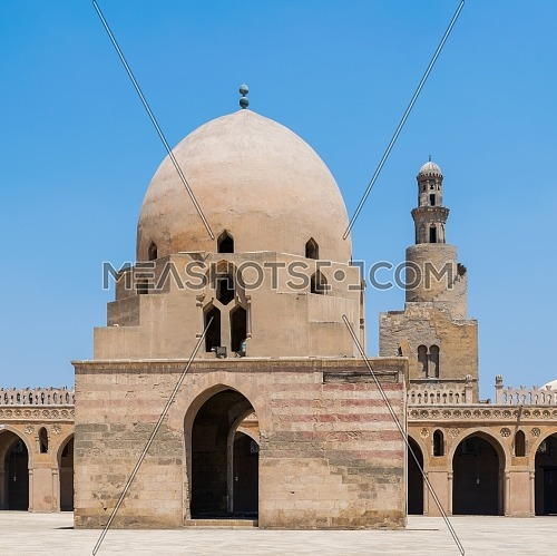 Ablution fountain at the courtyard of Ibn Tulun public historical mosque and the minaret of the mosque in the background, Old Cairo, Egypt