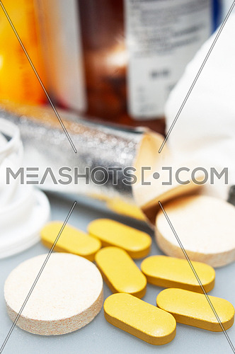 selection of different type vitamin pills closeup