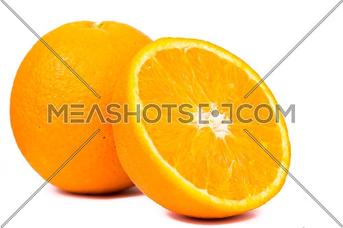 an orange and a fresh half orange  isolated on white