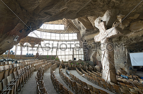 Cairo, Egypt - December 18 2016: View of St. Samaan the Tanner Hall showing a big cross at a huge cave, Saint Samaan The Tanner Monastery