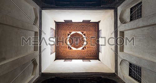 Wooden ceiling of a rooms of El Sehemy house, an old historic Ottoman era house in Cairo, built in 1648, with interleaved wooden windows (Mashrabiya)