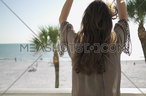 woman relaxing by the beach