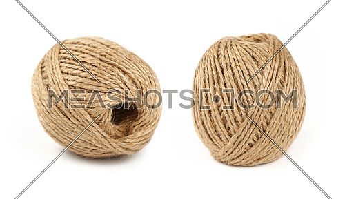 Two small coil bobbin of natural brown twine hessian burlap jute rope over white background