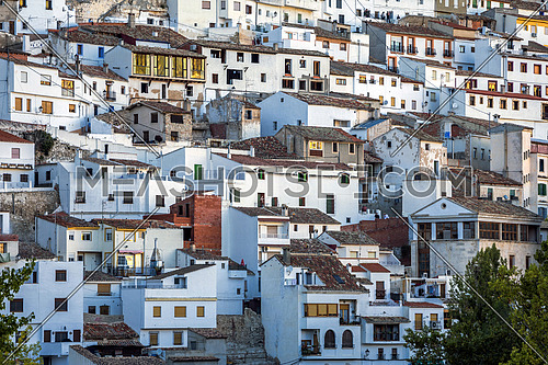 Alcala del Jucar, Spain - October 29, 2016: Houses and roofs next to mountain limestone, view to the mountains of the river Jucar, take in Alcala del Jucar, Albacete province, Spain