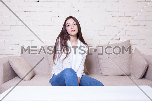 A gril sitting on a couch