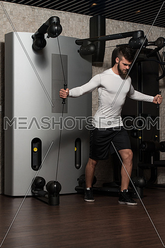 Handsome Man Is Working On His Chest With Cable Crossover In A Modern Gym