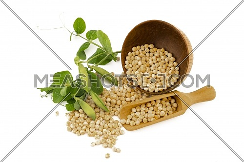Dried peas spilling from a rustic bowl and wooden scoop fresh plant with pods isolated on a white background