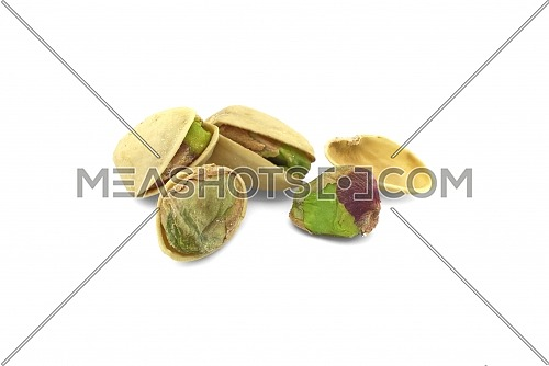 Pile of roasted and salted pistachios nuts isolated on white background