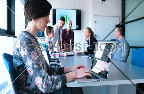 Business people using technology in modern office building