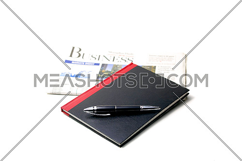 newspaper, pen and notebook on white background