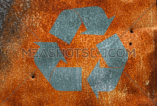 Old vintage bright rust stained corroded metal surface  with grunge recycling logo icon