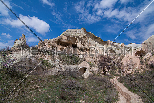 Goreme, Turkey - April 23, 2019: Rural Cappadocia landscape. Stone houses of Cappadocia.