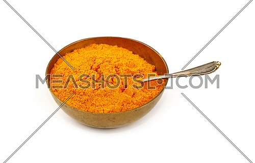 Close up one bronze metal bowl full of yellow turmeric powder spice with spoon isolated on white background, high angle view