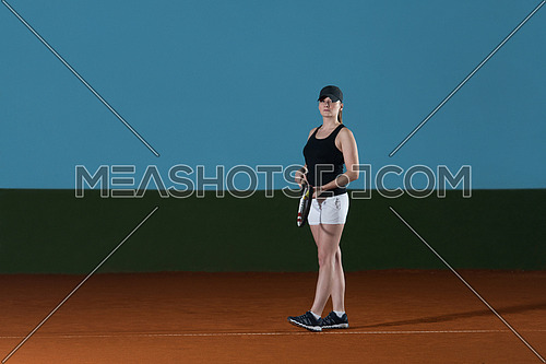 Portrait Of Woman Tennis Player With Racket Ready To Hit A Tennis Ball