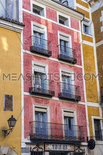 typical houses construction in the old town of the city of Cuenca, fronts painted with living colors, Cuenca, Spain