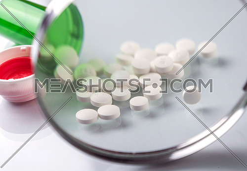 Pads white in a boat amb seen from a magnifying glass isolated in white background, conceptual image
