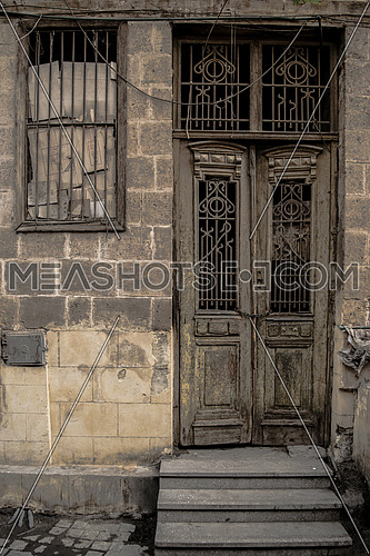 A vintage wooden door in a rural area