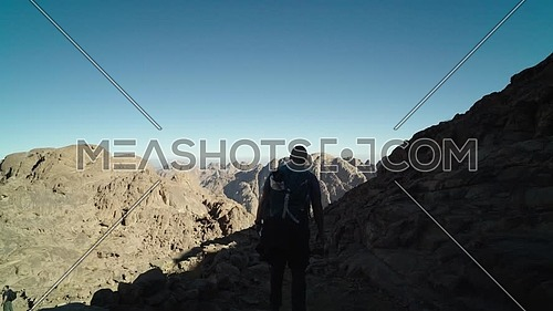 Follow shot for a male tourists exploring Sinai Mountain at day.