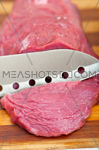 raw beef cutting on wood board ready to cook