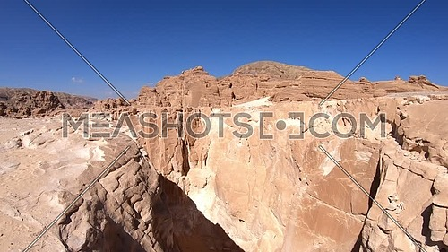 Tilt down shot for White Canyon in Sinai at day