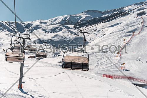 Ski lifts durings bright winter day