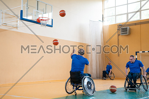 a war invalid in a wheelchair train with a ball at a basketball club in training with professional sports equipment for the disabled. the concept of sport for people with disabilities. High quality photo