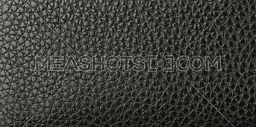 Close up background texture pattern of black natural leather grain, directly above