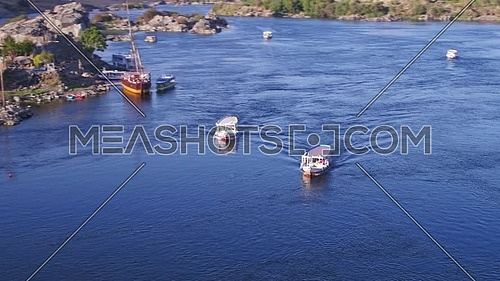 Aerial Shot for the River Nile showing two motorboats in Aswan at Day