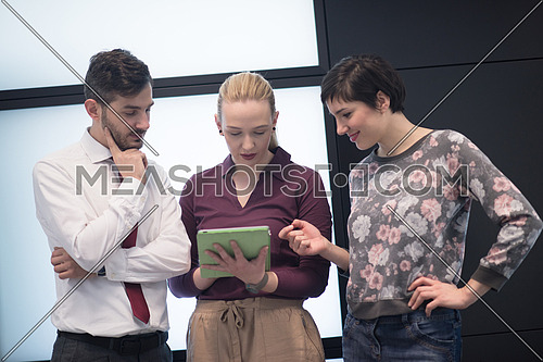 young startup business people group, brainstorming and working on tablet computer
