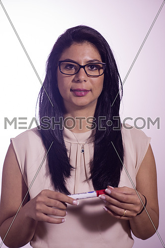 Middle eastern  business woman holding marker isolated on white background