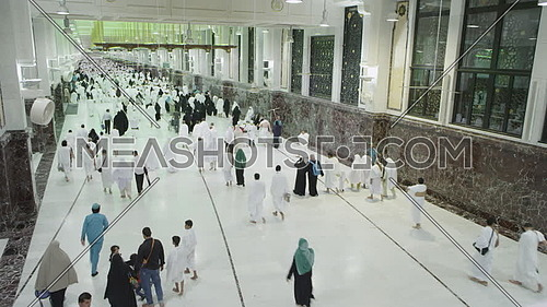 Long shot foe muslim people running at Safa and Marwa (Sai') for pilgrimage.
