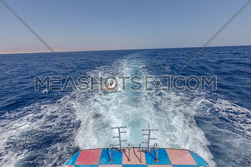 Long shot for backside boat showing Sharm El Shaikh City by day